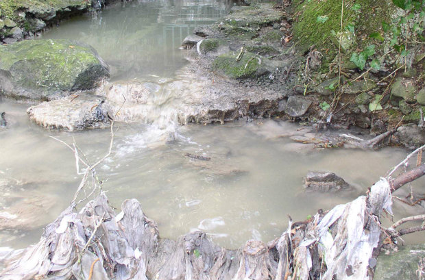 Blocked drain and polluted stream