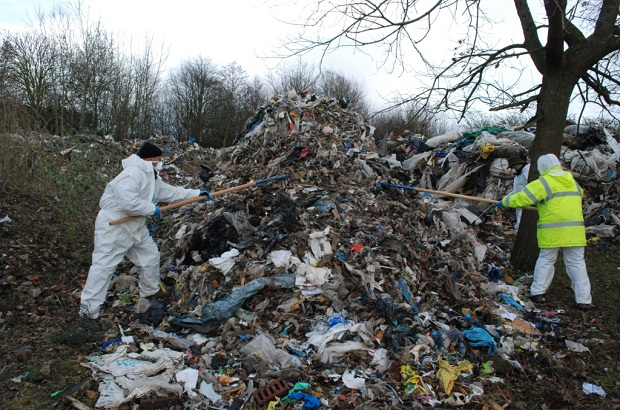 Environment Agency staff sifting through a waste pile in Hillingdon