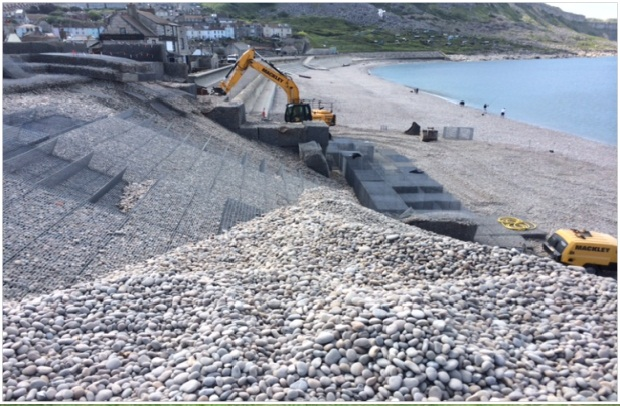 Photo shows work being carried out to the gabion 'castle' and crest of the shingle bank at Chesil beach in Portland, Dorset