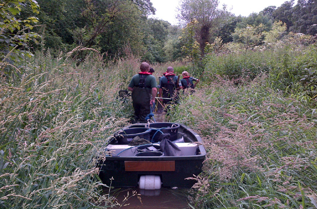 Fisheries team with a small boat doing a fish rescue