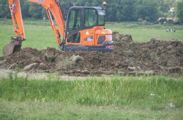 Photo shows an excavator carrying out repair work to North Barrier, near Muchelney on the Somerset Levels and Moors