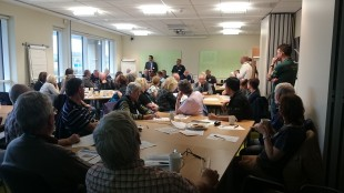 The room of flood wardens sitting in a large group session.