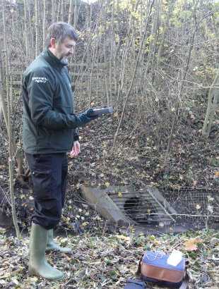 Member of the Clean Stream Team checking for water pollution