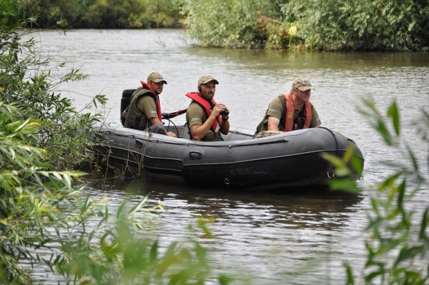 Fisheries enforcement officers  on a boat patrol in Cheshire