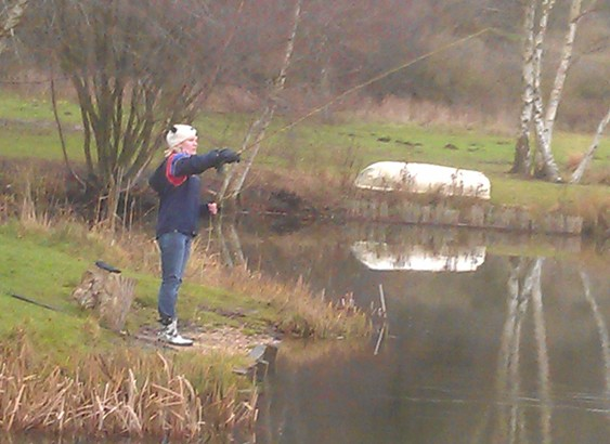 Woman fishing on bank