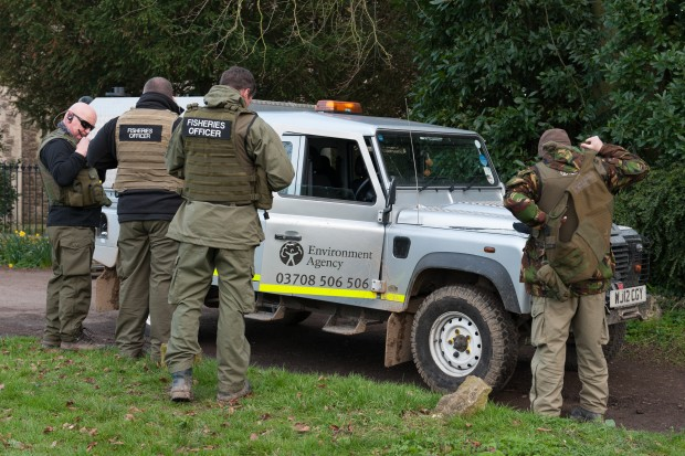Fisheries enforcement officers  put their kit on in Cheshire before their morning briefing