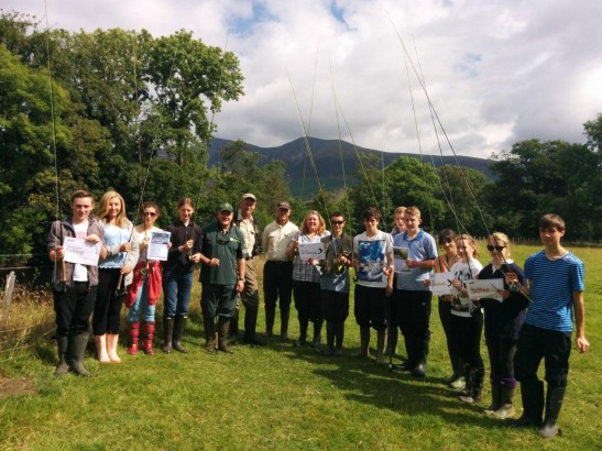 Mike Farrell stood with children from the West Cumbria fishing project
