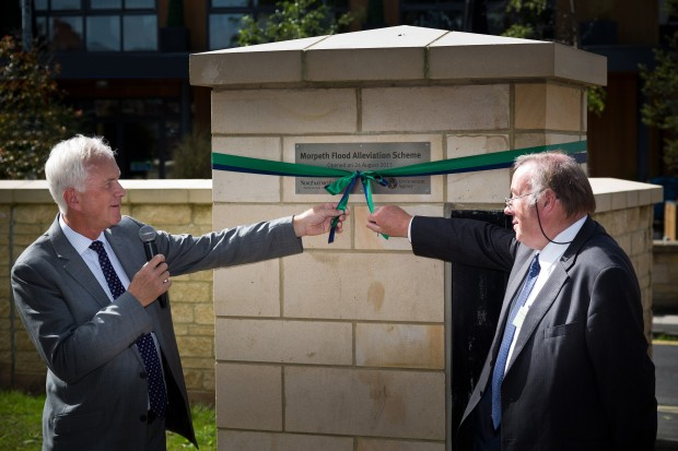 The moment Environment Agency Chairman Sir Philip Dilley and Cllr Ian Swithenbank from Northumberland County Council open the scheme