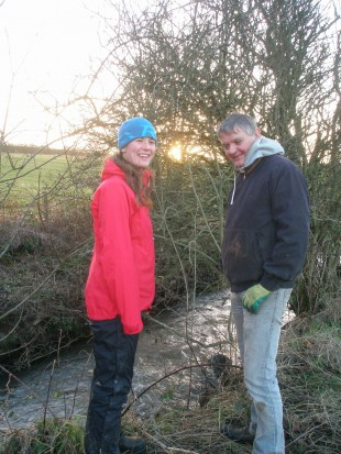 Rosie Law from West Cumbria Rivers Trust discussing fencing options with Mr Harrison, a local farmer