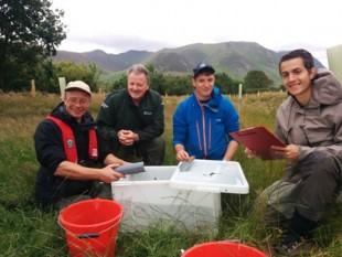 Ian Creighton (West Cumbria Rivers Trust), Mike Farrell (Environment Agency) and students from Aberystwyth University carrying out a fish survey on Whitbeck in the Lorton Valley