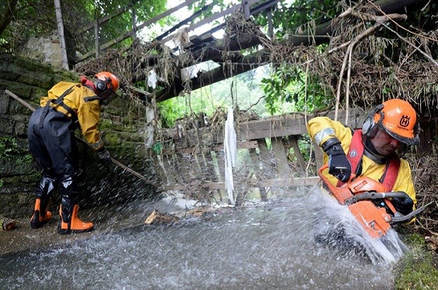 Dated: 05/07/2012 Environment Agency staff clearing a water course of debris from last weeks floods in Lanchester, County Durham, ahead of forecasted torrential rain which is due to hit areas of the UK over the next few days.