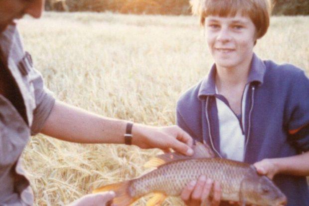 Nick the Door Knocker aged 12 with John Bailey and a wild Carp