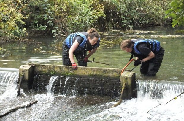 Removing the wooden boards at Harpers Weir
