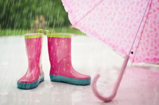 Child's pink wellies and umbrella