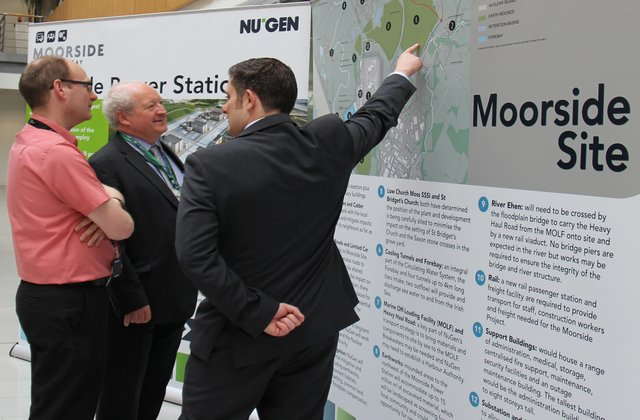 Man points to a map of the Moorside site in West Cumbria