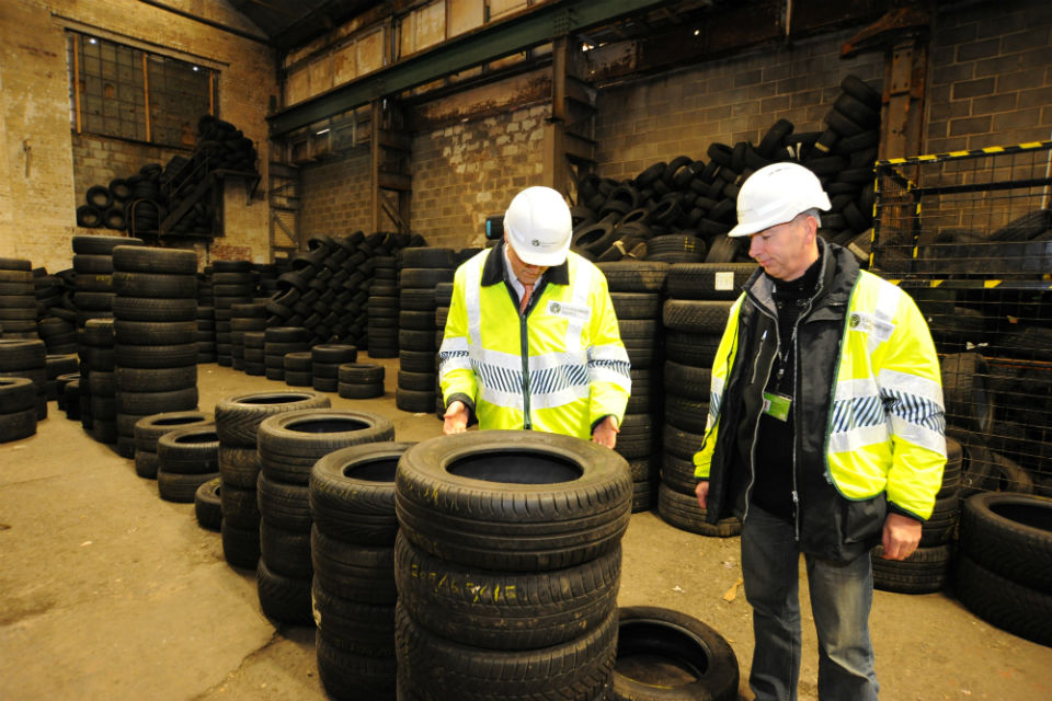Environment Officers inspect waste tyres