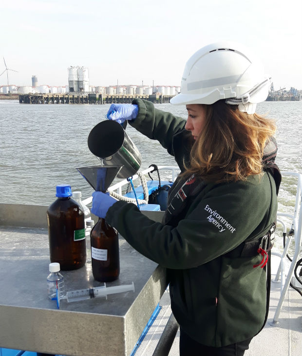 Marine Technical Specialist Claire Miller testing water samples