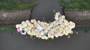 View from the air of large sandbags placed to block a breach in a river bank