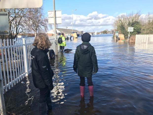 Image of two people in flood water