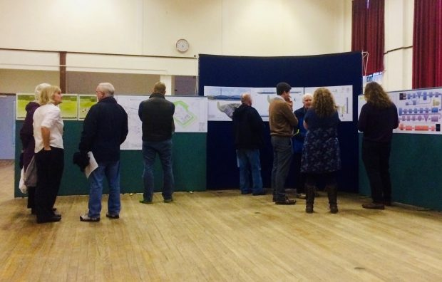 A group of people attend a public consultation
