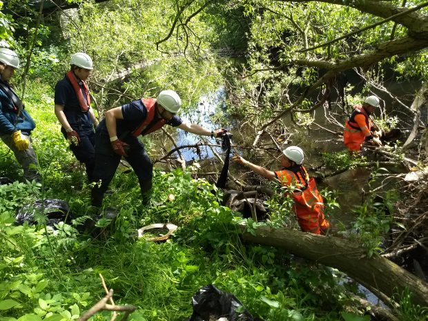 Volunteers take part in a clean-up of the River Aire as part of the DNAire project