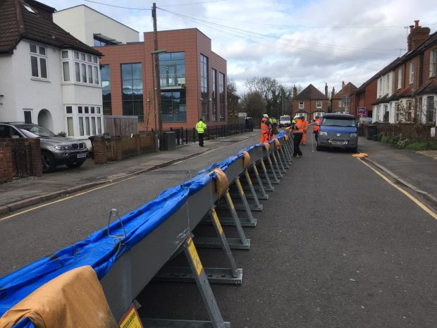 temporary flood defence barriers in the middle of a road