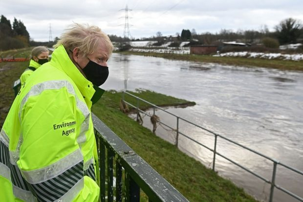 Prime Minister Boris Johnson overlooking a flood plain
