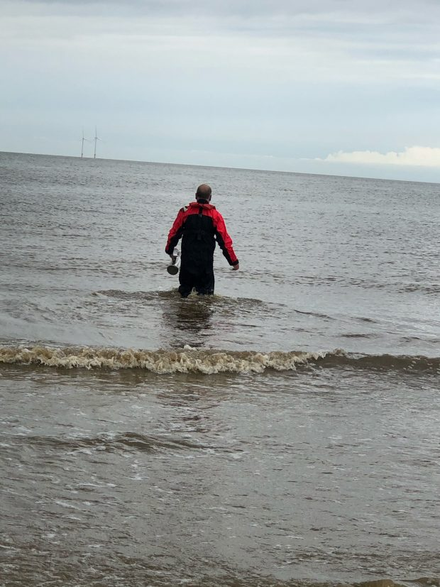 an image of a man in bathing water