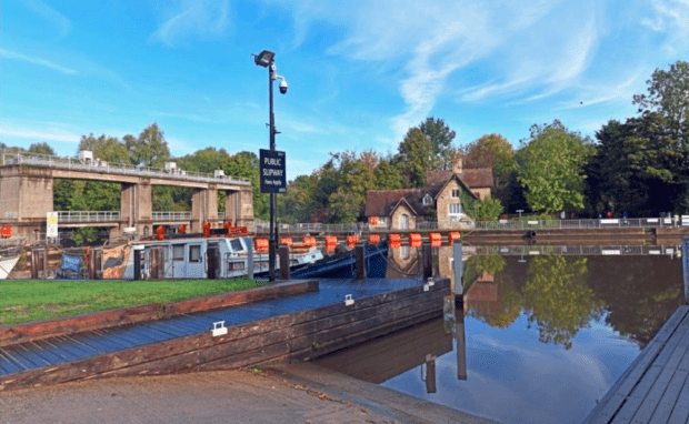 Allington Lock and lock keepers cottage. Boat and slipway in foreground.